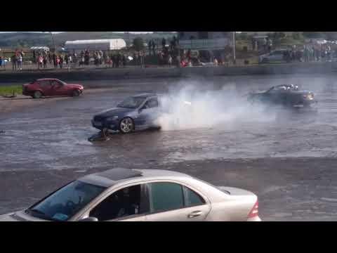 cars drifting in