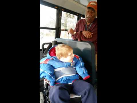 A very special young boy and his bus aide