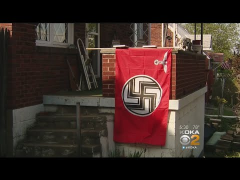 Man Takes Down Nazi Flag After Neighbors Complain