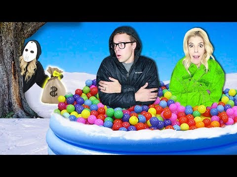 LAST TO LEAVE Giant Ball Pit in Snow Wins $10,000! (Game Master Hidden Clues & Rebecca Zamolo Twin)