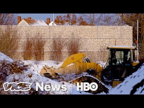 German Town Builds A Barrier Taller Than The Berlin Wall To Separate Refugees (HBO)