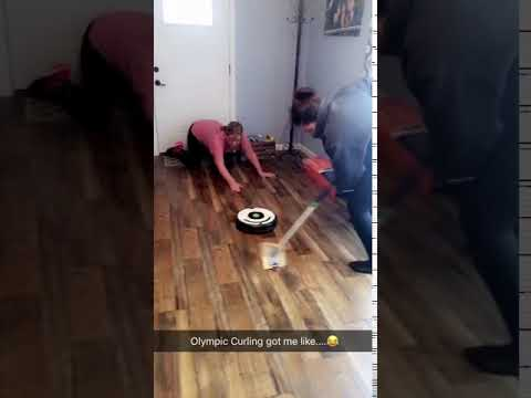 Curling event with vacuum robot and broom - 984342