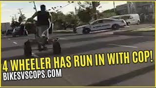 4 WHEELER HAS RUN IN WITH COP ON THE STREET
