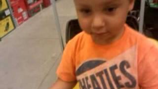 Liam drives a lawn mower