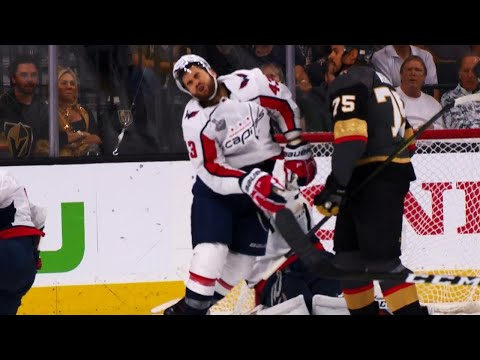 Tom Wilson eats the stick and gloves of Ryan Reaves