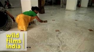 Women making rangoli  during a competition - Jagannath Utsav