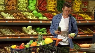 Guy Chooses Marrow at the Supermarket | Stock Footage - Videohive