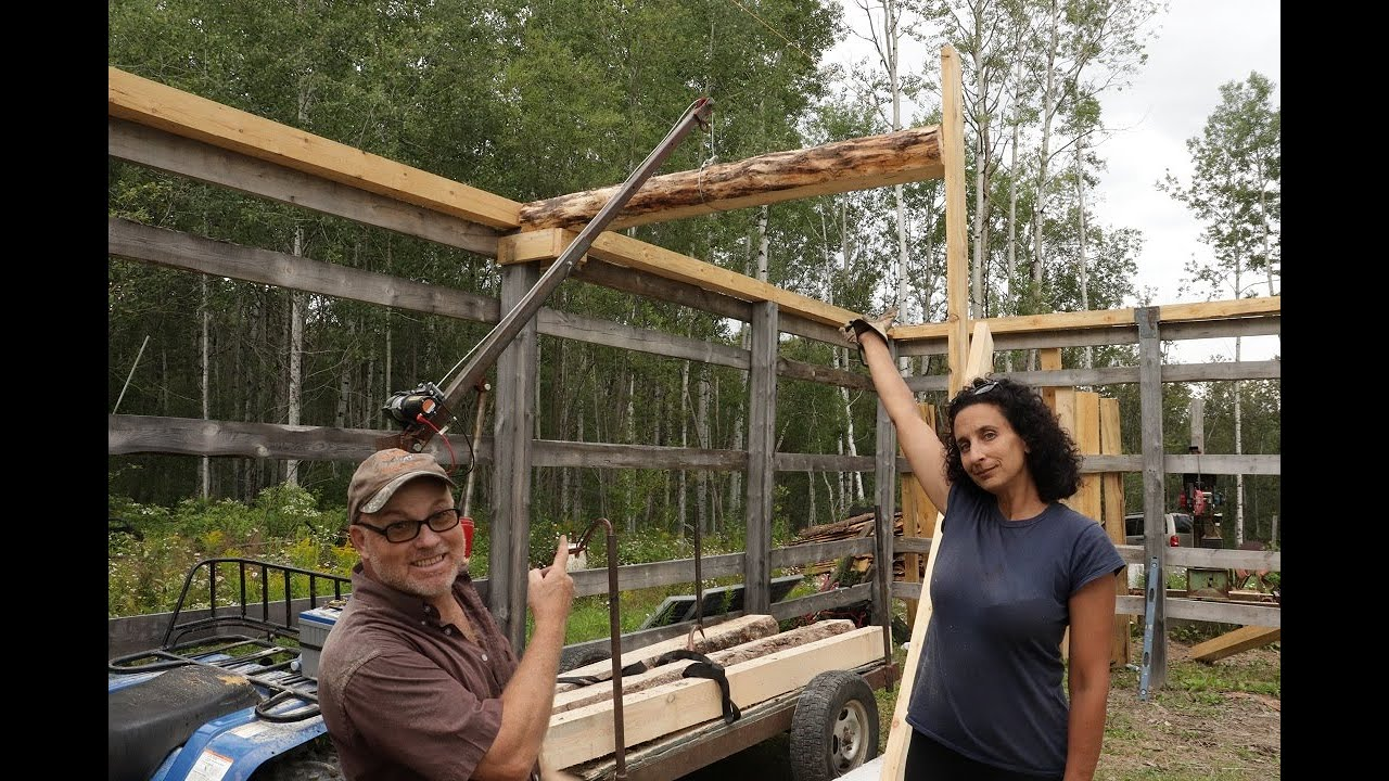 She's Happy Now, One Floor Joist Beam Installed On Our Off Grid Pole Barn.
