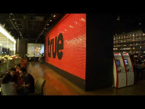 True coffee shop in Bangkok, Thailand's paragon mall. Flip dot sign being used.