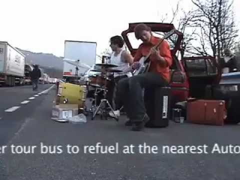Sean Noonan Norbert Burger play concert on highway in Italy