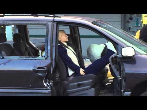 Legs on dash of van when airbag deploys