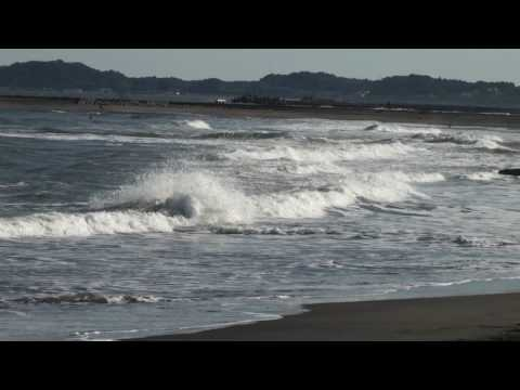 Surfers at surf beach at Ichinomiya, Chiba, Japan