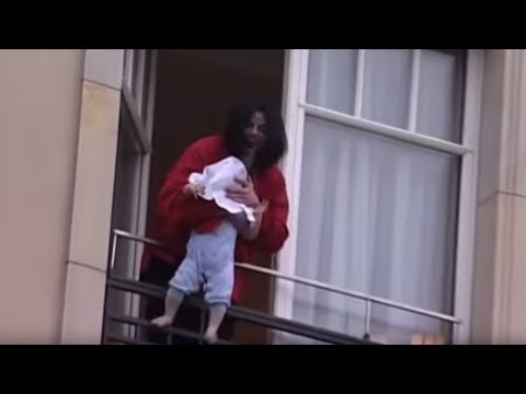 Michael Jackson dangles his baby over a hotel balcony