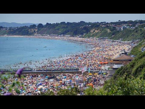 UK heatwave: Summer revellers flock to Bournemouth beach to enjoy the sun