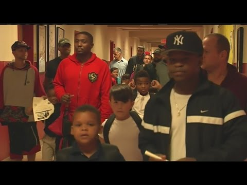 More than 100 dads march through the halls of Holyoke Community Charter School with their children