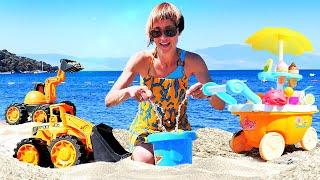 Фото Машинки на пляже и Маша Капуки. Видео и игры для детей в песочницу