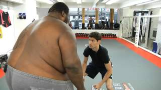 Ben sumo wrestles Manny, the world record holder for heaviest athlete.