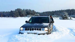 Jeep Grand Cherokee в снегу на спущеных колесах 0,6 атм. ч.2.