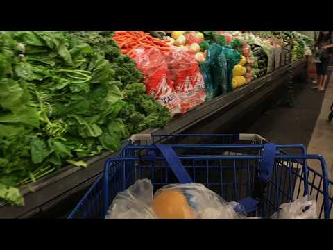 Shopping Cart With Grocery Moving Through Aisles Of Supermarket - Free Stock Footage