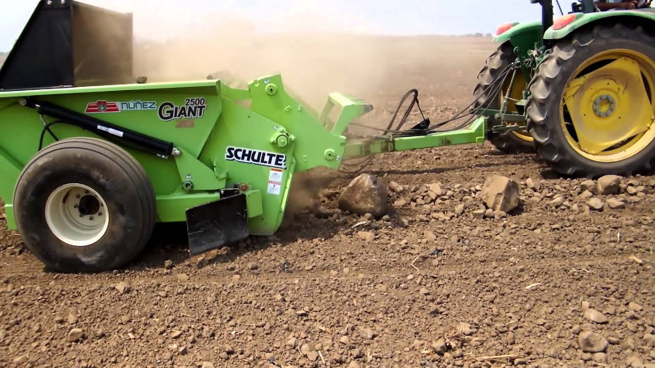 Rock Picking Machines : Rock picker and windrower schulte picking stones youtube