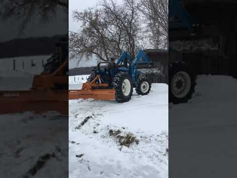 Ford 5610S with New Holland 7410HD loader selling at auction 3-1-19