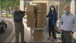 Massive pizza delivery to local hospitals