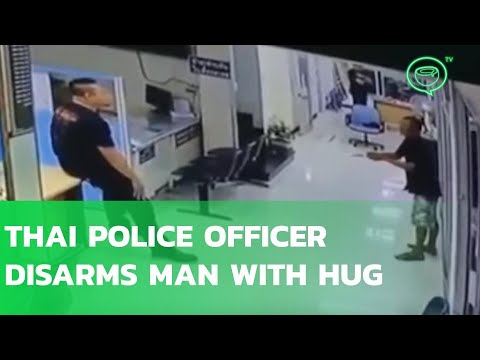 Thai police officer disarms man with knife with a hug | Coconuts TV