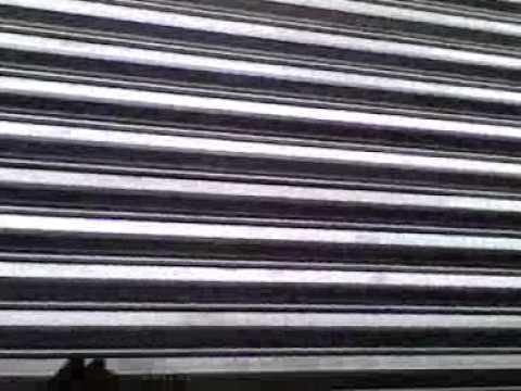 Colocacion de cortina de acero con sistema de cadena 5 8 - Cortinas de cadenas ...