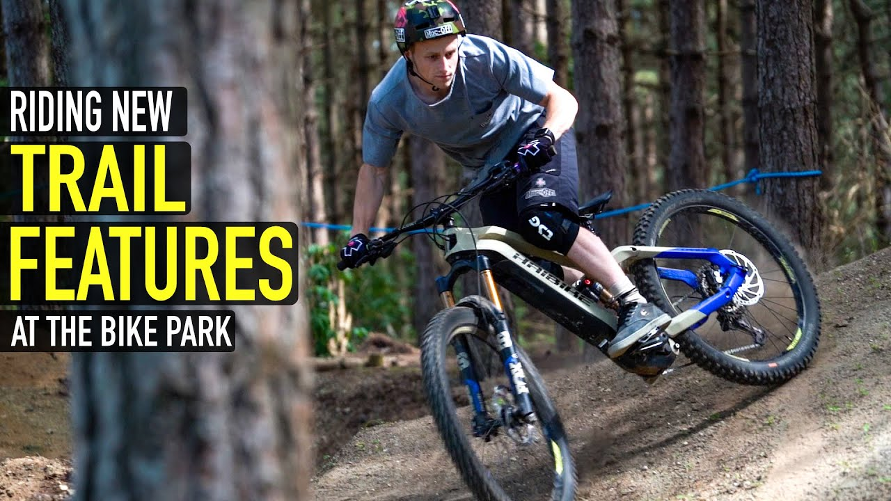 RIDING NEW TRAIL FEATURES IN A BIKE PARK!