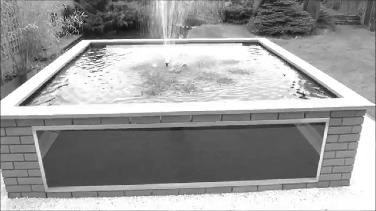 Bespoke raised koi pond with windows instantpond youtube for Koi pond window