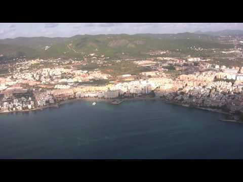 Landing at Ibiza Airport feat aerial views of Ibiza's East Coast