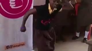 School girl displays best Ghanaian dance moves.
