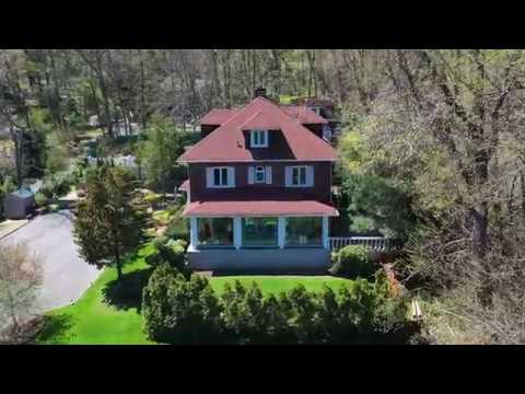Luxury  water view single family in Great Neck drone video - Barbie Li's Team