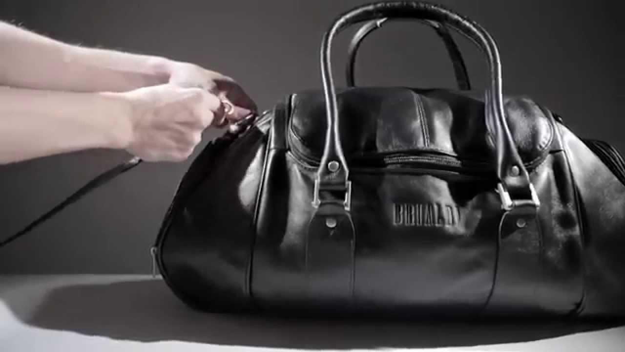 Вещмешок [d068] из темно-серого вощеного хлопка и натуральной кожи. Duffel bag of dark-grey waxed canvas and black leather. Lodbrog. 9500 ₽. Дорожная сумка // journey. Дорожная сумка // journey. Wield craft. 24990 ₽. Спортивная кожаная сумка walleysmark