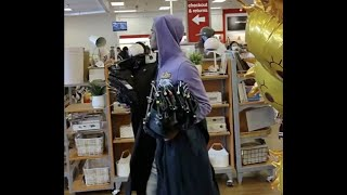 CAUGHT ON CAMERA: Shoplifters stroll out of TJ Maxx overloaded with stolen items.