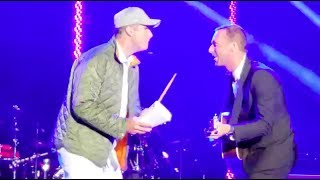 Chris Martin performing with Will Ferrell on cowbell (2018)