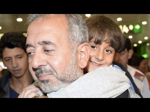 Spain welcomes Syrian dad tripped by camerawoman near Hun...