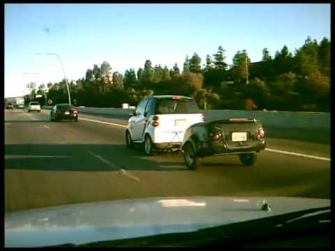 Smart Car Towing A Trailer