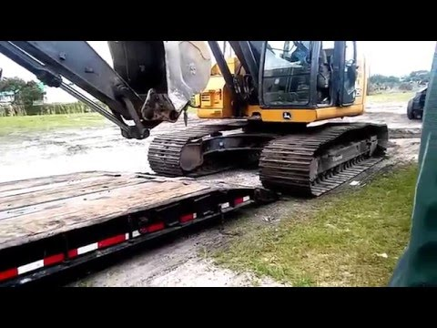 How to load a excavator and a milling machine on a lowboy trailer