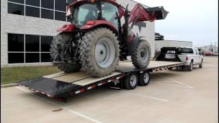 PJ Gooseneck Hydraulic Dovetail Loading a Case IH Maxxum 130 - PJ Trailers