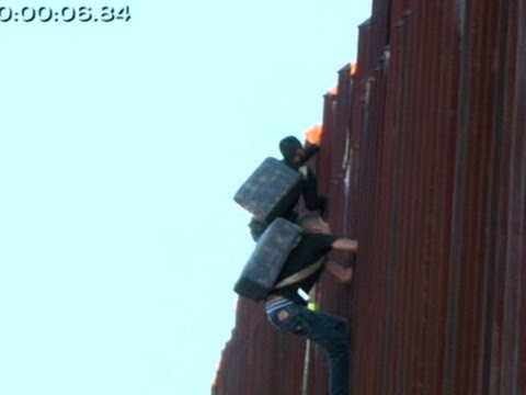 Suspected Smugglers Scaling US Border Fence