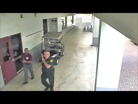 Surveillance video shows armed deputy standing outside during Florida school shooting
