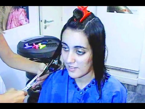 Coloring black and a very sexy haircut on the brunette girl with huge blue eyes