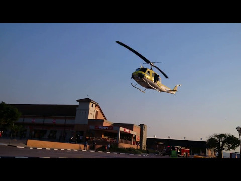 Huey Helicopter landing at Shopping Mall