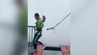Safety cord falls off harness as man hops on high bridge in SW China