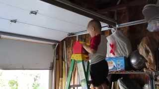 Kid using Tools to fix Garage