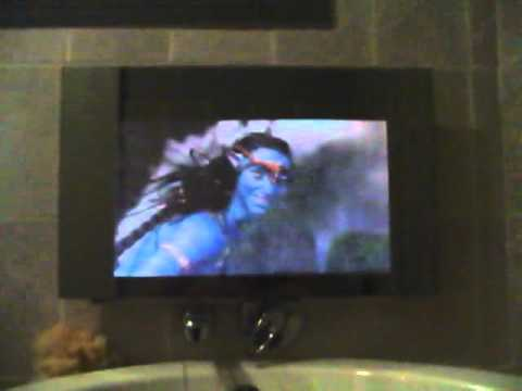 Lcd Tv Behind A Two Way Mirror