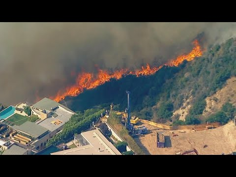 Fast-moving fire threatens Pacific Palisades homes