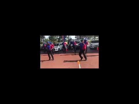 Engen Garage petrol attendants dancing to mandoza's nkalakatha