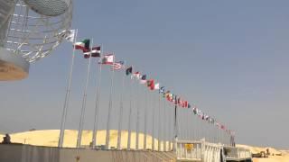 الكرة الارضية تتوسط أعلام دول العالم فى قناة السويس الجديدة